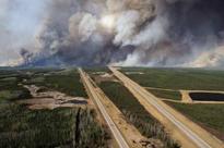 Alberta wildfire singes companies beyond energy sector