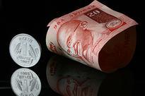 Rupee trade marginally higher on dollar selling