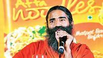 Delhi court restrains sale, publication of book on Ramdev