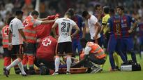 Andres Iniesta leaves game on stretcher with knee injury