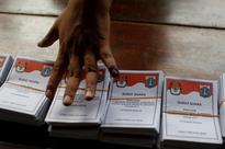 Analysis - Indonesian president faces twin threats from Jakarta poll