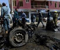 Kabul suicide bombing of NATO convoy kills 14