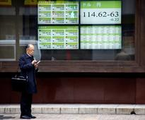 Global Markets - Dollar firm in Asia, resource shares on the run