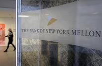 UPDATE 1-BNY Mellons activist board member praises progress, even as stock slumps