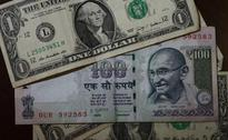 Rupee trading weak at 67.01 on heavy dollar demand