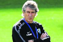 Malaga sad to lose coach Pellegrini to Man City
