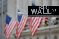 Wall Street retreats after surge; Caterpillar, financials fall