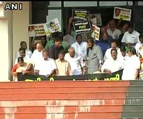 Kerala Chief Minister Oommen Chandy presents budget amid protests by Opposition