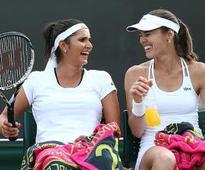 Sania-Hingis advance to quarter-finals
