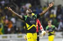 Belligerent Russell muscles Jamaica to the top