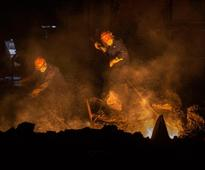 Enter the dragon: Let these fiery photos take you inside a huge steel plant in China