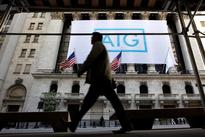 AIG returns to pre-bailout paydays for CEO, top execs