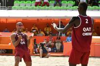 Qatar duo upset FIVB World Tour veterans in Ol... Qatar's Jefferson Santos Pereira (L) celebrates with Qatar's Cherif ...
