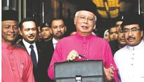 Najib delivers Malaysian budget amid protests