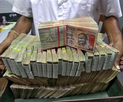 Rupee up 14 paise against dollar in early trade