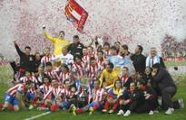 Atletico stun Real in extra-time to lift title