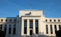 Fed lifts rates, sees faster pace of hikes in Trump's first year