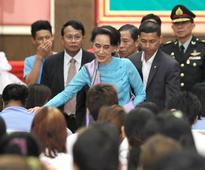 Suu Kyi tells migrant workers to follow Thai rules