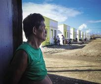 Typhoon Pablo victims formally get homes
