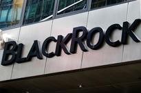 Low-fee BlackRock funds reel in cash but earnings disappoint