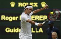 Below-par Federer into Wimbledon second round