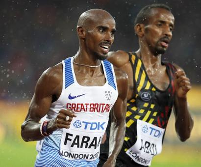Farah advances in 5,000 metre for final assault on track gold