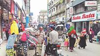 Footpath, road grabbing woes for Khulna pedestrians