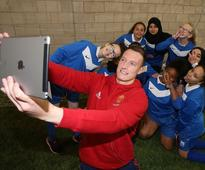 Wayne Rooney and Man United team-mates surprise schoolkids with kickabout at Carrington training HQ
