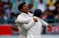 Kuldeep shines on debut, Australia all out 300