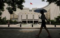 Chinese central bank says economic growth prospects have improved