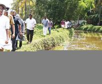 Locals come together to clean up dying Kanampuzha river