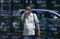 Asian shares wobble, oil firms after rout