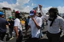 Venezuelan opposition leader Henrique Capriles tear-gassed during protest