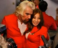 Video: Richard Branson does drag on flight