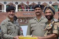 Pakistan Rangers gift Eid sweets to Indian BSF at Wagah border