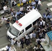 Japan knifeman who murdered 19 disabled people grins after arrest