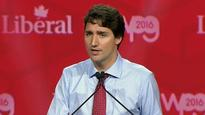 Bob Rae apologizes for 'gagging' at Trudeau's praise of Harper