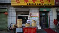 China's consumer want to dine out more, buy cars: Survey