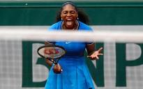 The Latest: Rain halts play with Williams sisters on court