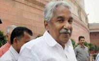 Kerala Chief Minister Oommen Chandy Inaugurates Digital Library