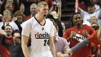 Spencer Hawes misses open fastbreak dunk, hangs on rim (video)