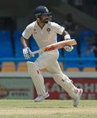 Ashwin century, Kohli double ton as India run  cricket riot