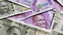 Flush with cash, banks cut FD rates