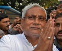 Nitish Kumar formally takes over a..