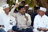 AAP-BJP tussle intensifies, Kejriwal flays Modi's Gujarat model