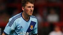 Danny Whitehead: Cheltenham Town loan Wigan Athletic midfielder