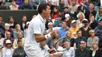 Milos Raonic moves on to quarter-finals at Wimbledon