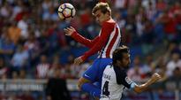 Atletico Madrid's Antoine Griezmann downs Deportivo La Coruna