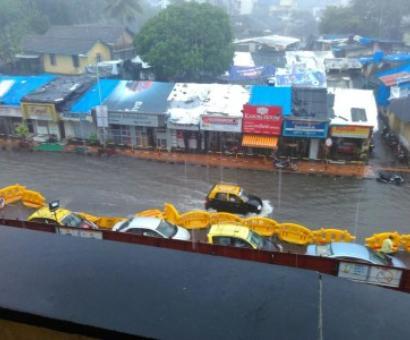 Mumbai commuters hit by rains, derailment