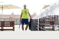 Tennis at Emirates Palace: Peter Wessels, meet Hugh Grant